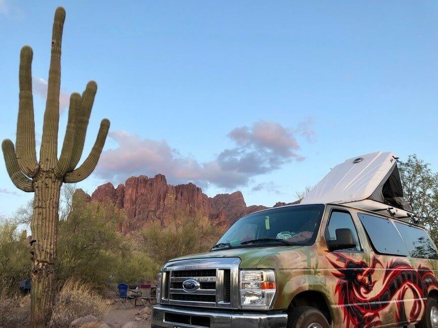 Campervan by a cactus in the desert